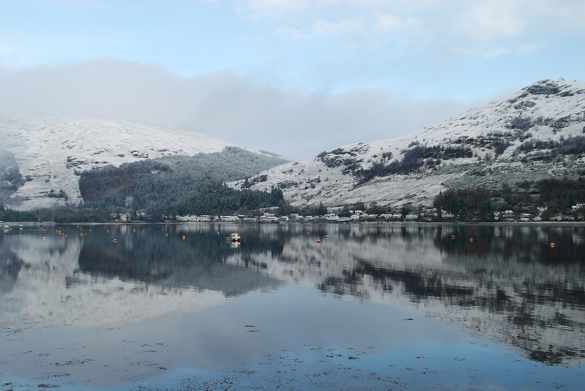 The view from Argyll Holidays of a snowy loch and mountains