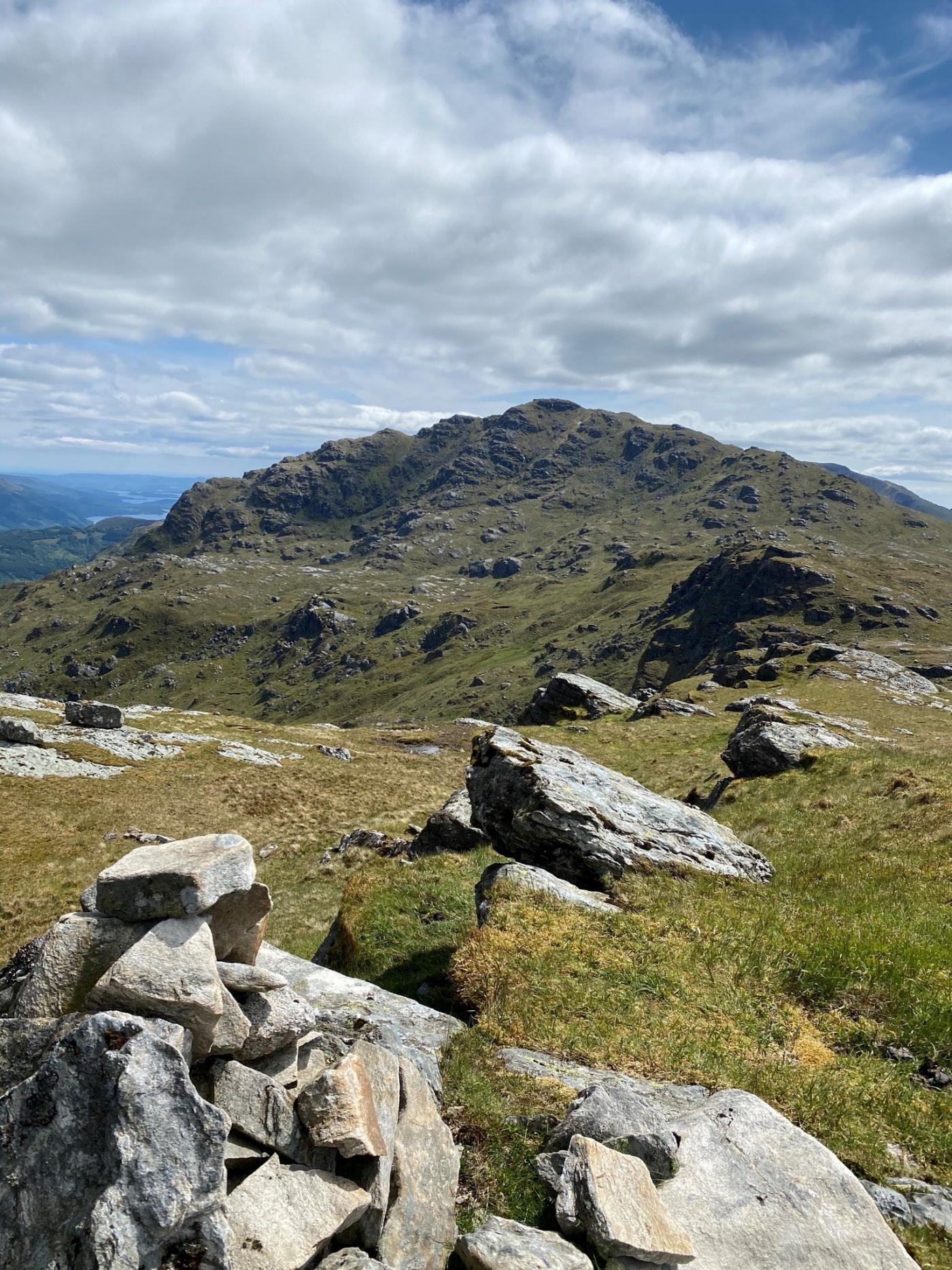 Summit of Beinn Dubh looking across to Ben Vane. This was taken on a bright and sunny 11th June.