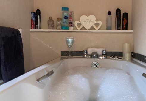 Why not have a nice hot bath and a cheeky glass of wine?