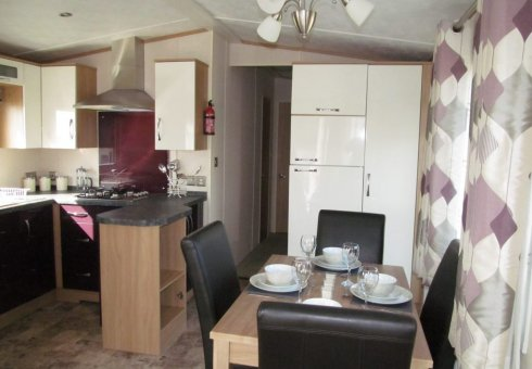 Large integrated fridge freezer and dining area.