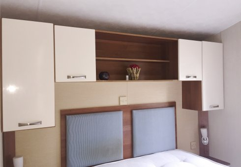 Spacious main bedroom with ample storage.