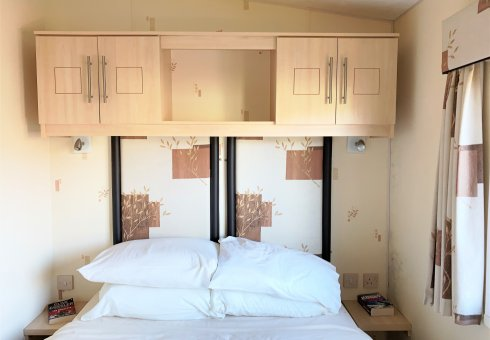 Twin bedroom with over head storage.