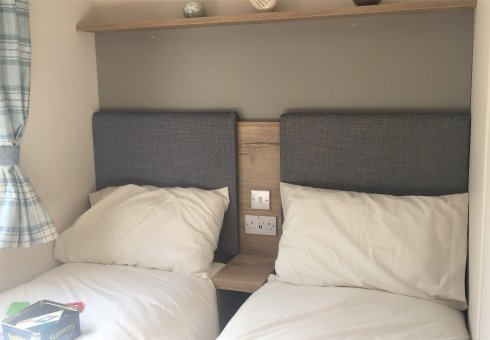 Twin bedroom with with comfortable padded headboards.