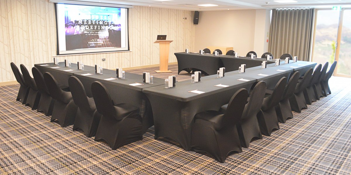 A conference table set up at Drimsynie Estate