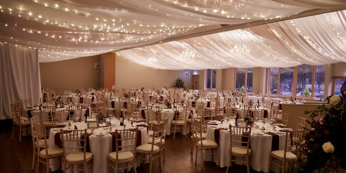 Fairy lights in the wedding room at Drimsynie Estate
